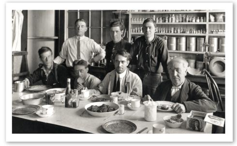 "Teamwork was an essential part of the invention factory ""magic"". Pulling ""all-night""creativity sessions was not unusual at all. Here in a famous photo, Edison takes a meal with his famous ""insomnia squad""."