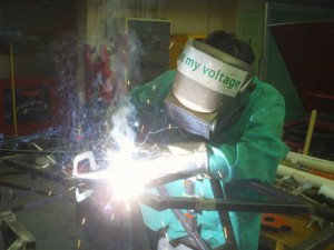 Student welding the vehicle chassis