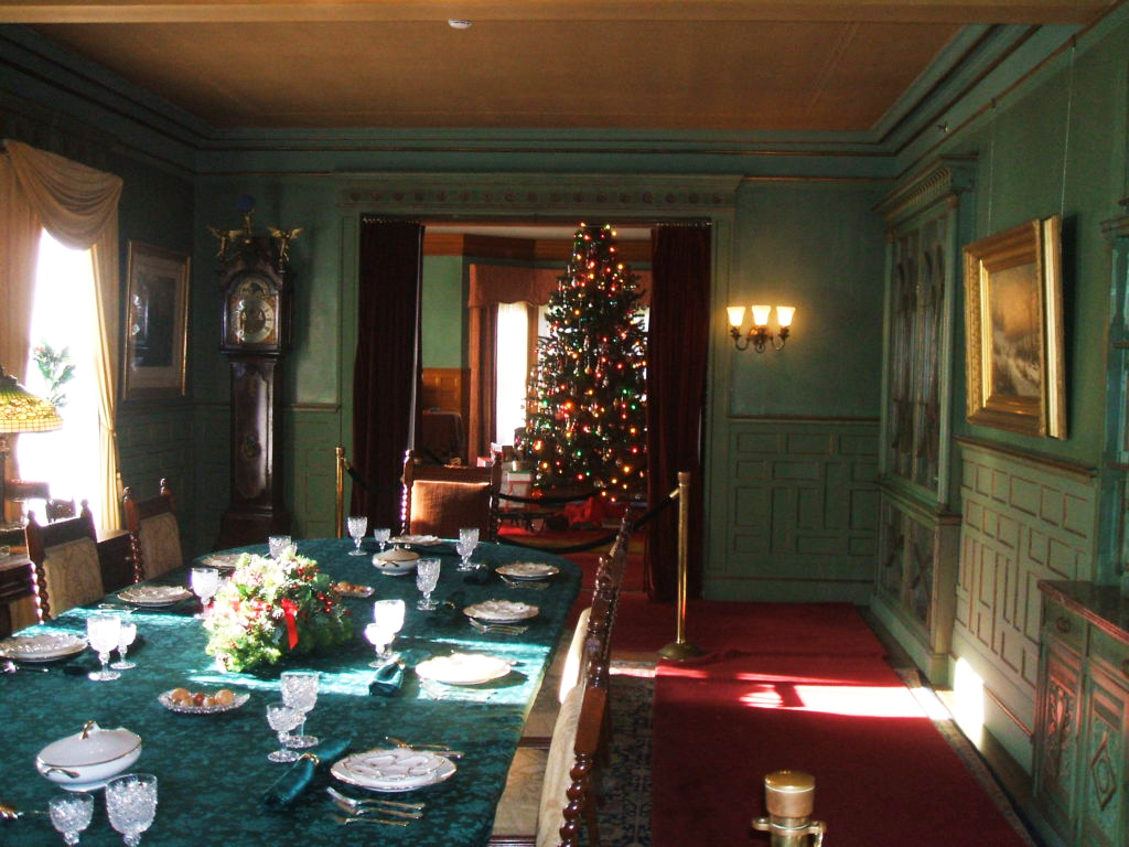 Looking from the dining room into the family den where the main Christmas tree was normally located--with original children's gifts shown under the tree. Dinner for family & friends-30 folks could be seated for the festive feast.
