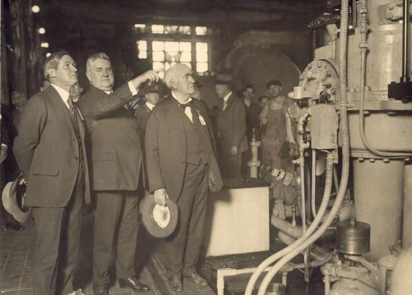 Thomas N. McCarter, founder and President of PSE&G explains a tour of the new Kearny Generating Station in 1925 to Gov. of NJ, A. Harry Moore (left) and Thomas Edison (right)