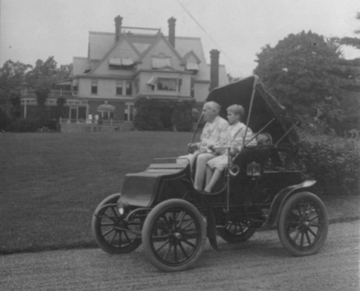 Son Charles driving Edison around the Glenmont property