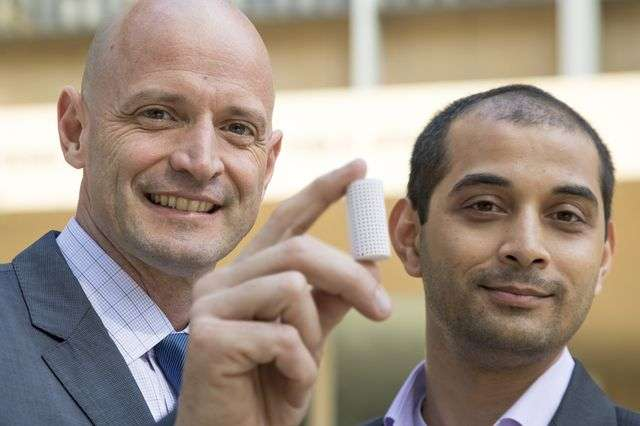 J.R. DeShazo, left, and Gaurav Sant show off a sample of the new building material they have created to replace concrete.