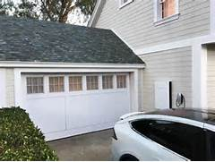Garage roof with glass solar panels