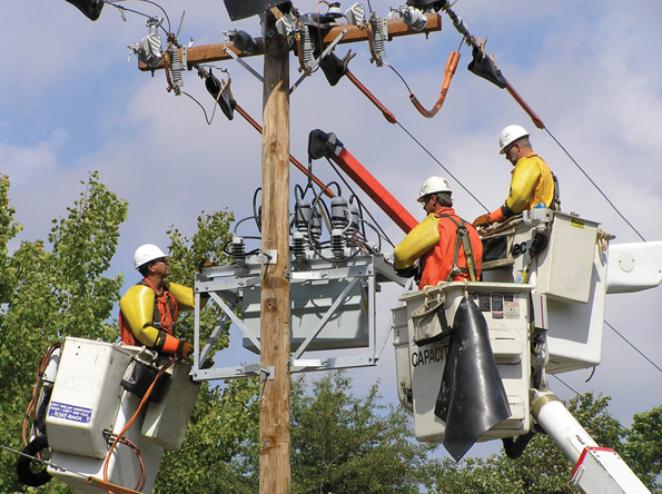 Utility Workers Busy Maintaining High Service Reliability for Customers