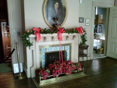 The Edison bedroom fireplace and mantle colorfully decorated.